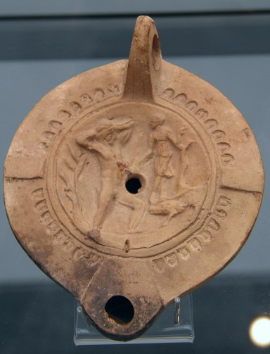 Terracotta oil lamp depicting a blinded Orion and Artemis