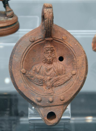 Terracotta oil lamp depicting Serapis above an eagle spreading its wings, 2nd century AD