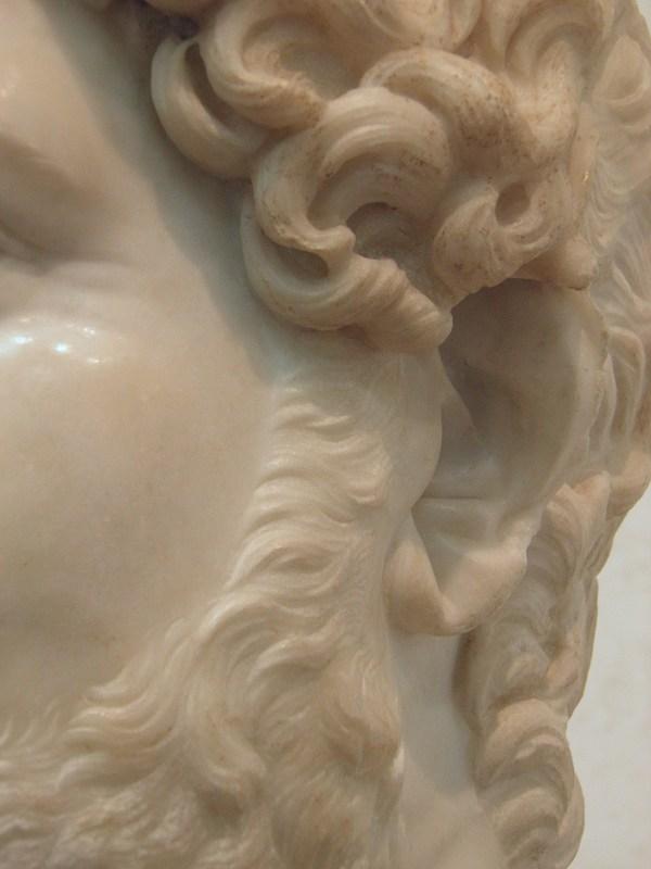 Hadrian's earlobe showing a deep diagonal crease (Palazzo Massimo alle Terme, Rome).
