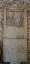 Sepulchral stele of Quintus Labienus Mollio and his wife Aquilia Tertia, 1st century AD, on display in the Temple of Augustus