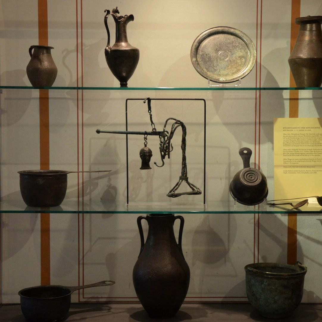 Antique bronze containers displayed in the culina (kitchen) Pompeiianum, Aschaffenburg, Germany © Carole Raddato