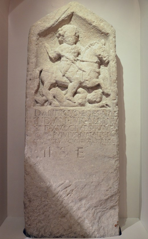 Tombstone of an auxiliary cavalryman called Dannicus, the deceased is depicted on horseback spear in hand with a fallen enemy at the horse's feet, 1st century AD, from Corinium Dobunnorum, Corinium Museum (Cirencester)