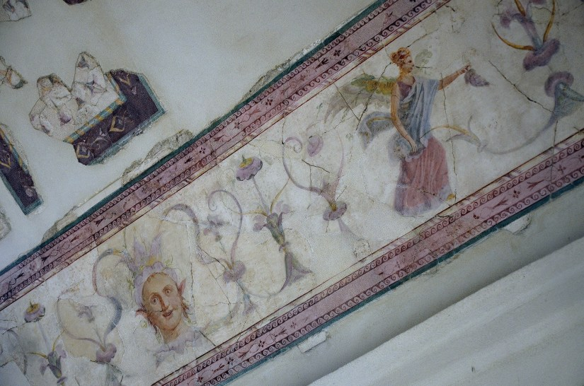 "The upper cubiculum so-called ""Emperor's Study"": painted frieze on the ceiling with winged female figure, satyr's head and plant-shaped motifs."