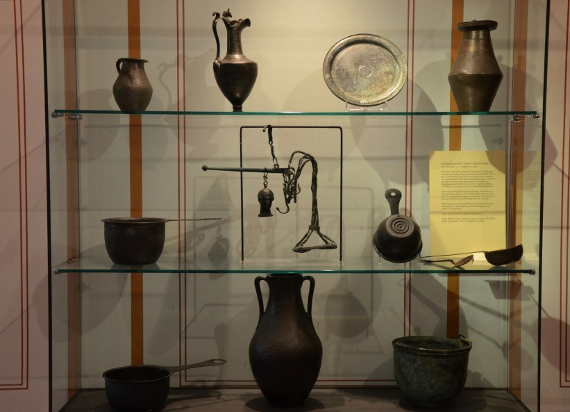 Antique bronze containers displayed in the culina (kitchen) Pompeiianum, Aschaffenburg, Germany © Carole Raddato