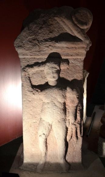 Stela depicting Hercules fighting.