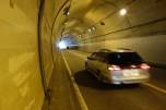 This tunnel doesn't have a barrier between the walkers and cars!