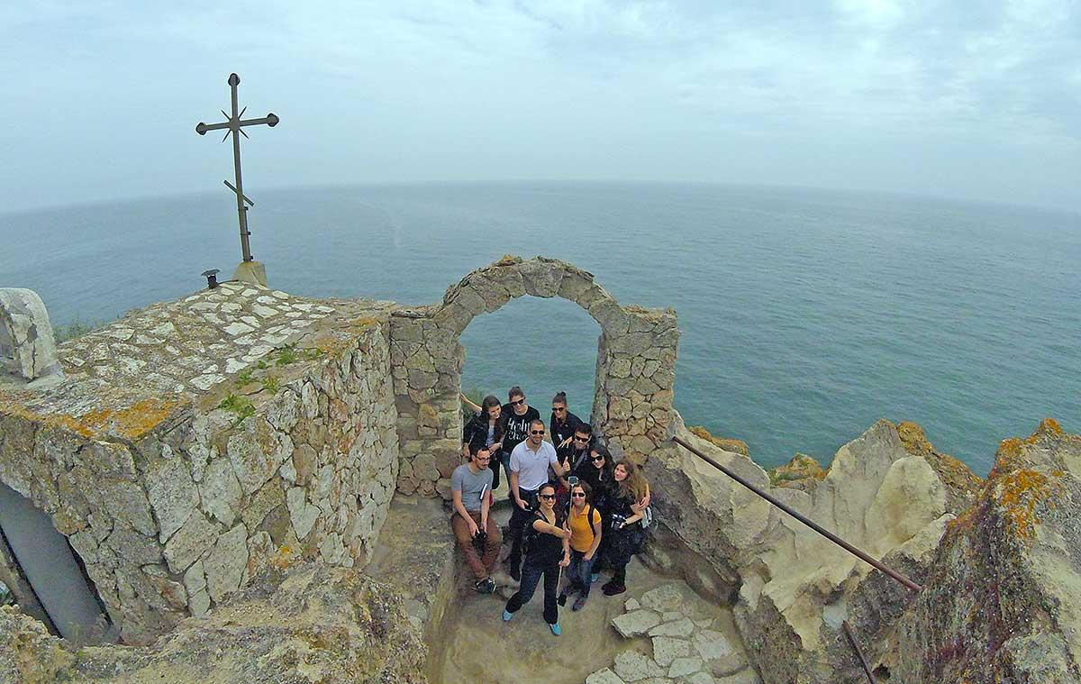 ASTOM team next to the chapel of St. Nicholas