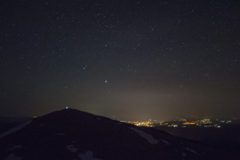 Lights from Buzludza peak at night