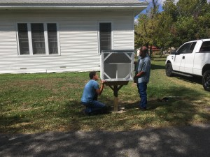 Steve and Mason install the Blessing Box