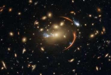 Hubble Captures a Dormant Galaxy Through a Cosmic Lens