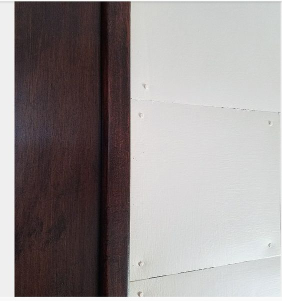 white shiplap with dark unpainted stained woodwork