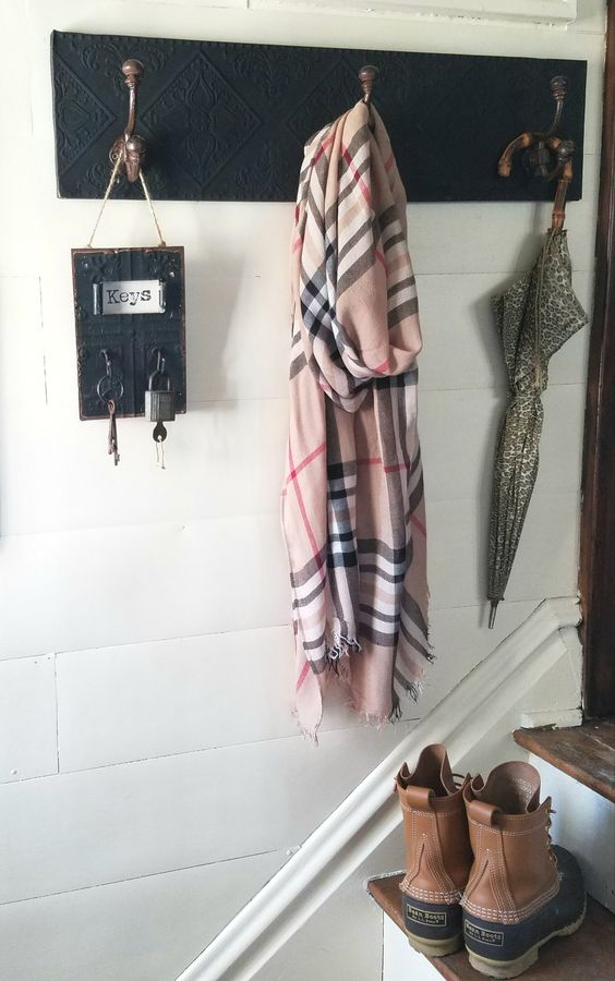 Farmhouse style entry way with coat hook plaid scarf bean boots
