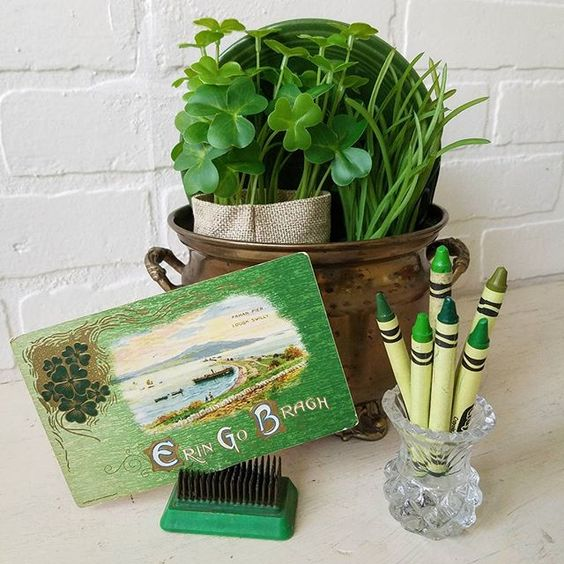 Vintage Saint Patrick's Day vignette antique postcards shamrocks green crayons brass Ideas for decorating with green