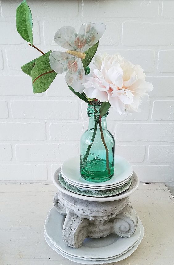 Faux Peony in a vintage glass bottle