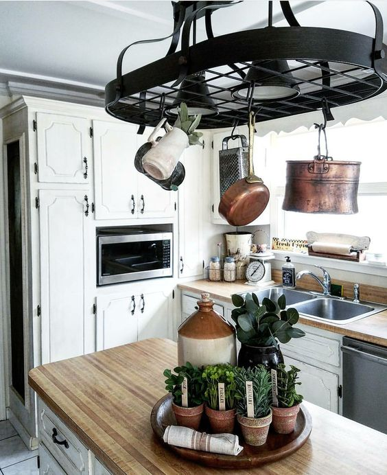 Gorgeous farmhouse style cottage kitchen copper, vintage crocks and faux herbs chalk painted kitchen cabinets