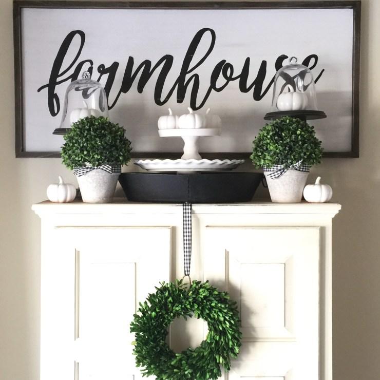 Gorgeous neutral black and white farmhouse fall decor white pumpkins boxwood wreath boxwood spheres