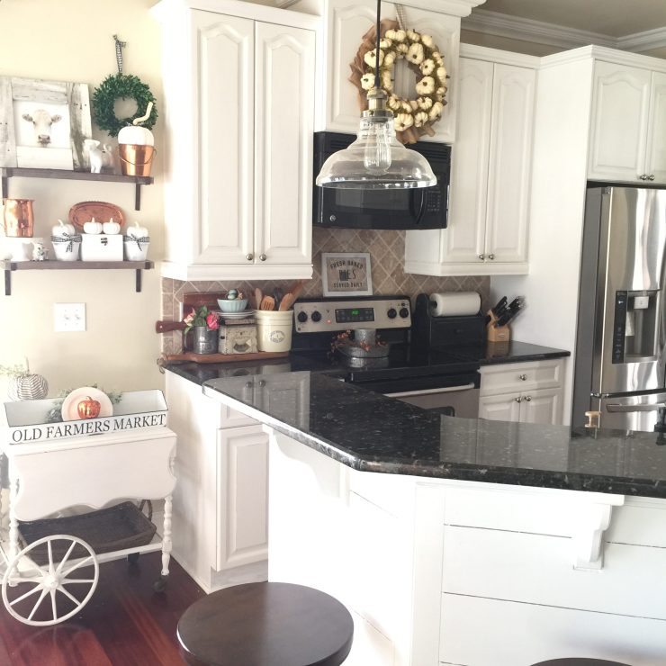 Gorgeous cottage farmhouse kitchen black countertops white cabinets fall kitchen ideas