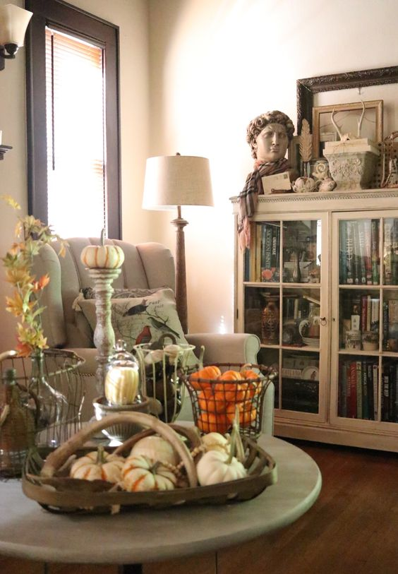 Gorgeous flea market style fall decor living room decorated for fall neutral walls dark woodwork