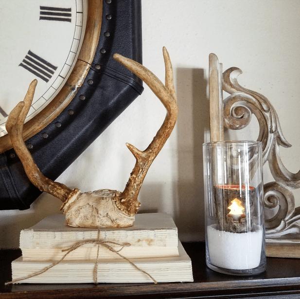 Rustic winter mantel antlers old books corbel neutral mantel hygge decor