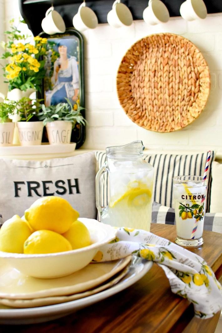 Beautiful early summer home tour farmhouse kitchen with lemons farmhouse pillows black and white kitchen ideas