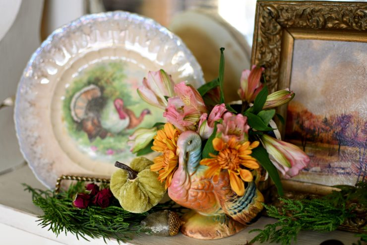 Beautiful vintage Thanksgiving vignette with vintage turkey plate and turkey planter with fresh bouquet