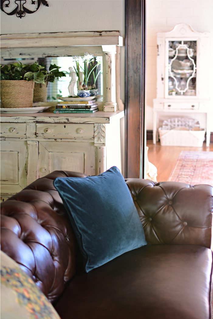 Blue velvet pillows brown Chesterfield sofa summer living room decor