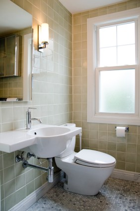 The sink is from Italy, from the Hastings showroom in the Merchandise Mart. The eco-friendly, dual flush toilet is Aquia Toto. The soft green, hand-glazed ceramic tile is from Italy. The hexagon floor and base is carrara marble. Wall sconces, mirror and toilet paper holder are Ginger Surface line..