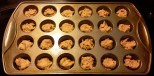 Filling the baking tin, the completed batter is still sticky, but easy enough to deal with using bare fingers.