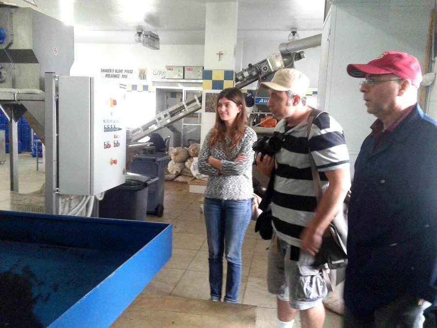 Bechara, on the right, explaining to his visitors how olive oil is extracted