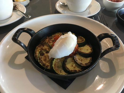 Poached egg on courgettes