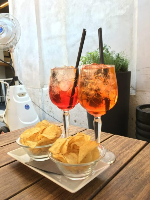 Two glasses with Aperol Spritz and Campari Spritz