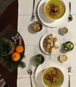Winter Solstice table: no-chicken soup, sourdough bread with butter, and smaller bowls with various snacks
