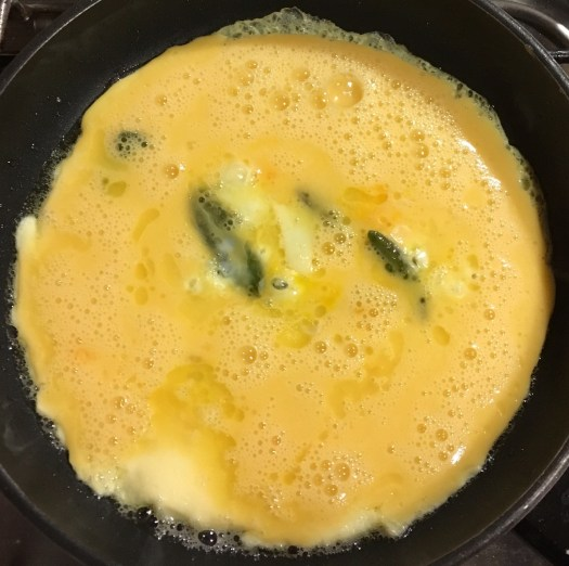 Half set omelette with sage and cheese