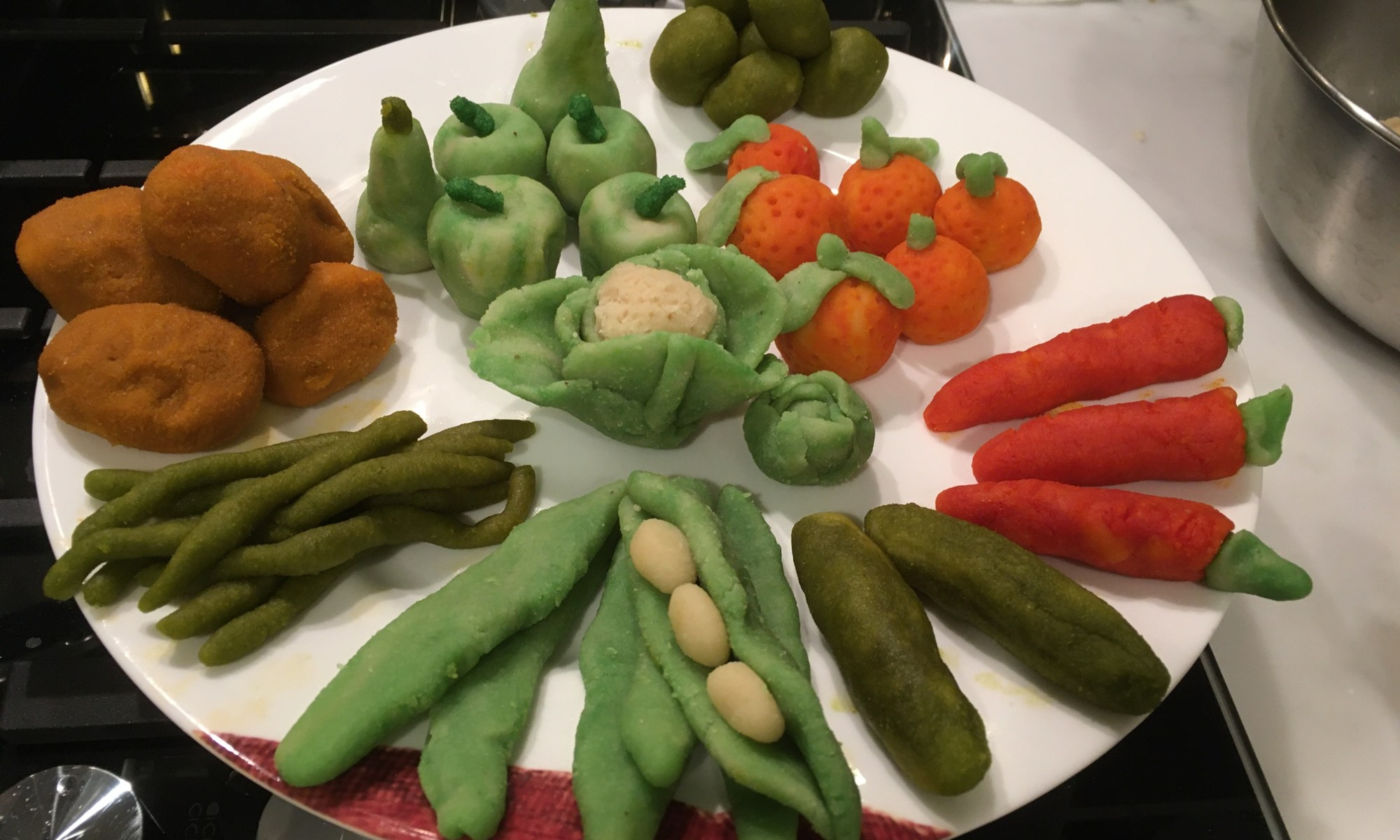 Sant Dionís sweets - from la Mocaorà - image depicting small colourful sweets shaped like fruits and vegetables
