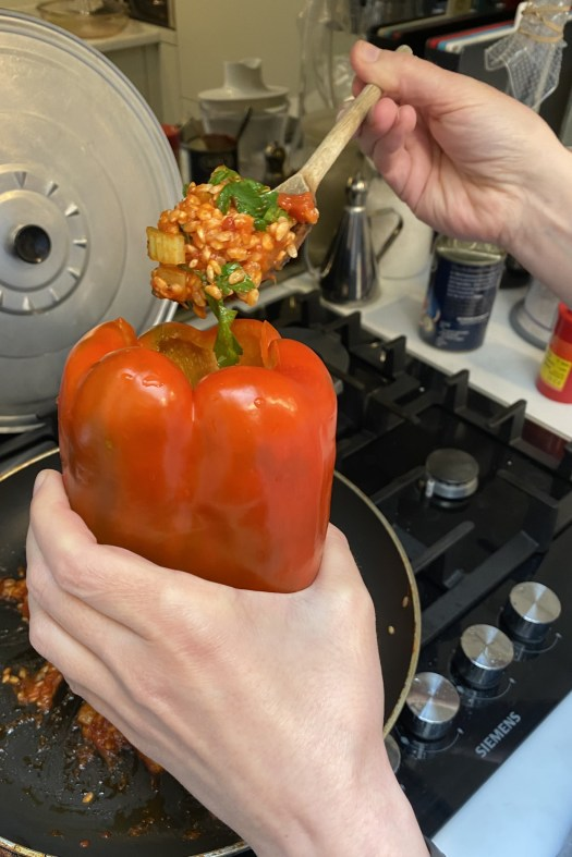 Stuffing the pepper with the rice mix