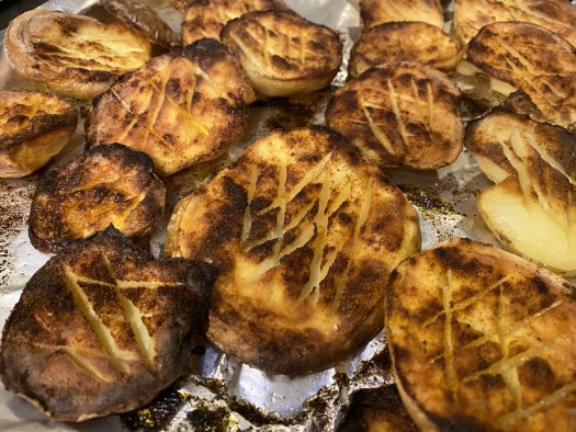 Close-up of cooked sliced potatoes on an oven tray