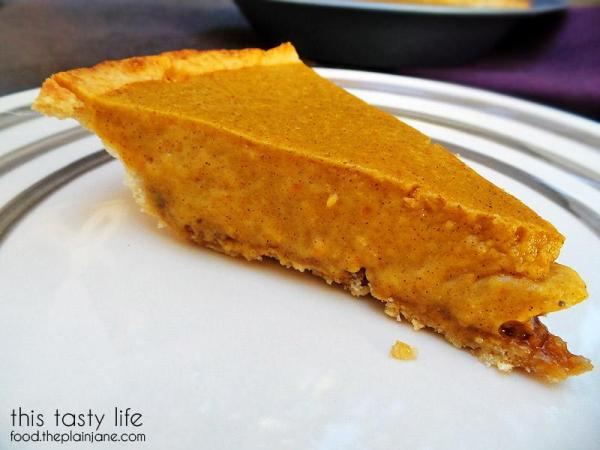 Slice of Pumpkin Pudding Pie with Pecan Crust | This Tasty Life - http://food.theplainjane.com