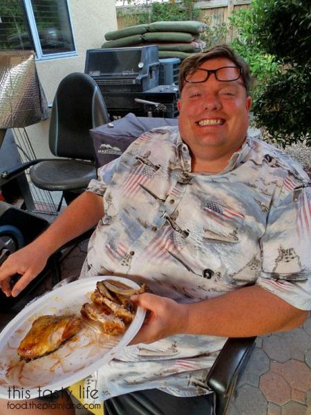 Jake eating smoked chicken