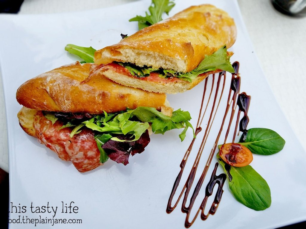 Corse Sandwich with Salami, Fig Chutney, and Gruyere Cheese at Le Parfait Paris   San Diego, CA