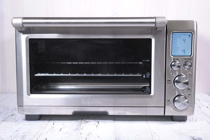 kitchen air cabinets layout breville bov900bss smart oven review best in class foodal sitting on a white painted wooden surface