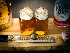 The completed Cinnamon Roll Shot made with Fireball Whisky, Boylan Creme Soda, whip cream, and fresh grated nutmeg.