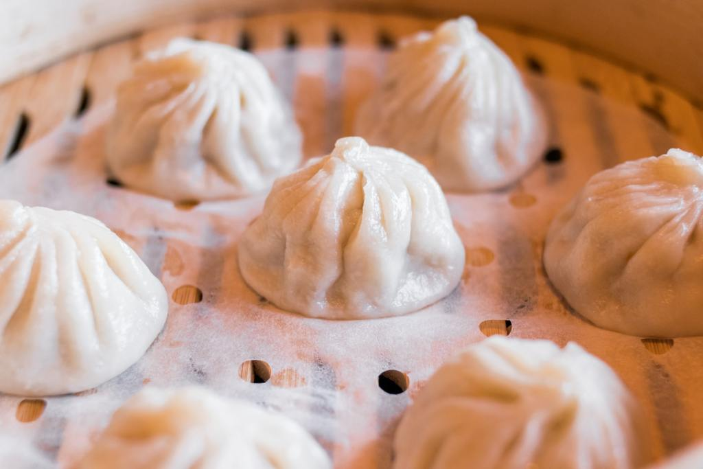 Soup dumplings in a bamboo steamer basket