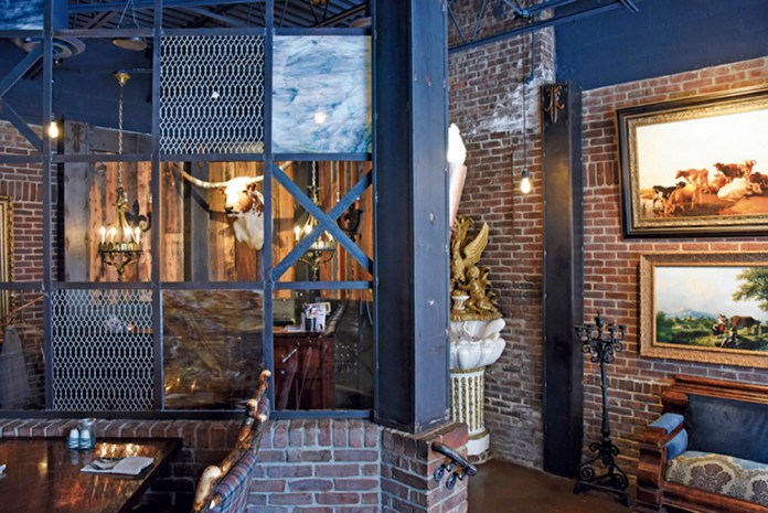 The entry sets the tone with a mash up of industrial chic and 19th century French-style paintings