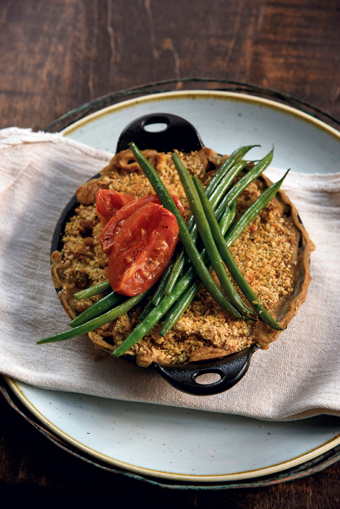 Vegan cassoulet of simmered white beans, oven-roasted tomatoes, leeks, haricot verts with an herb crust