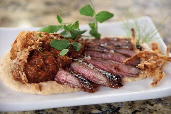 Bourbon flat iron steak with romesco and cornbread puree