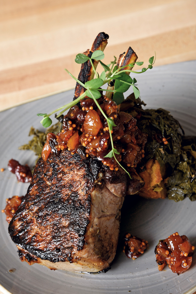 Double-bone pork loin chop with sage cornbread stuffing and braised greens
