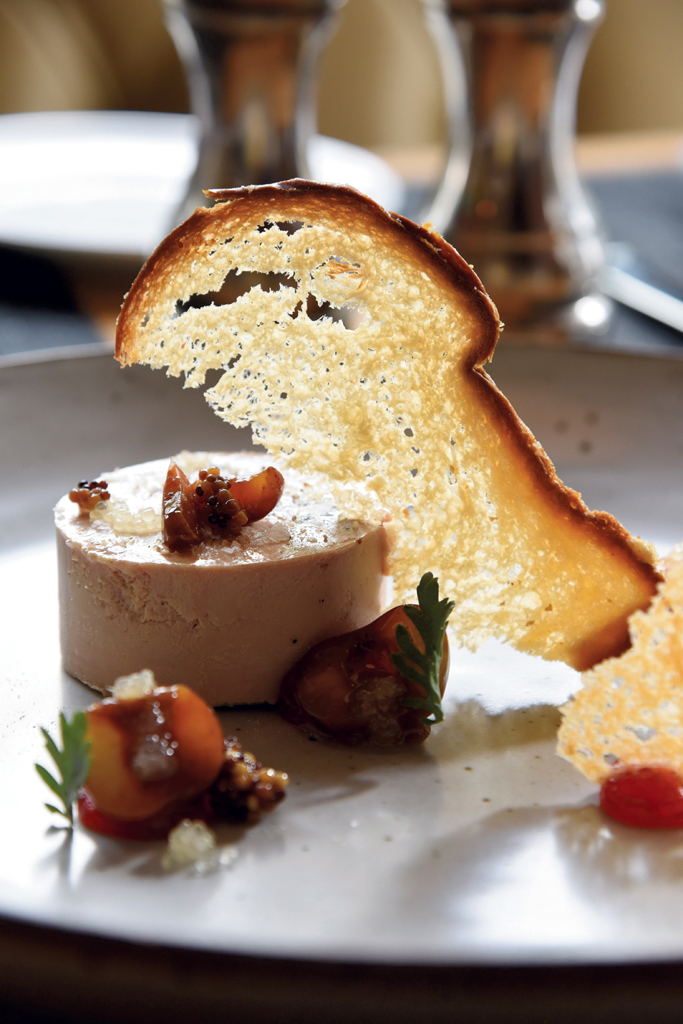 Foie gras torchon with cherry, cocoa nib, finger lime and rhubarb, with toasted brioche