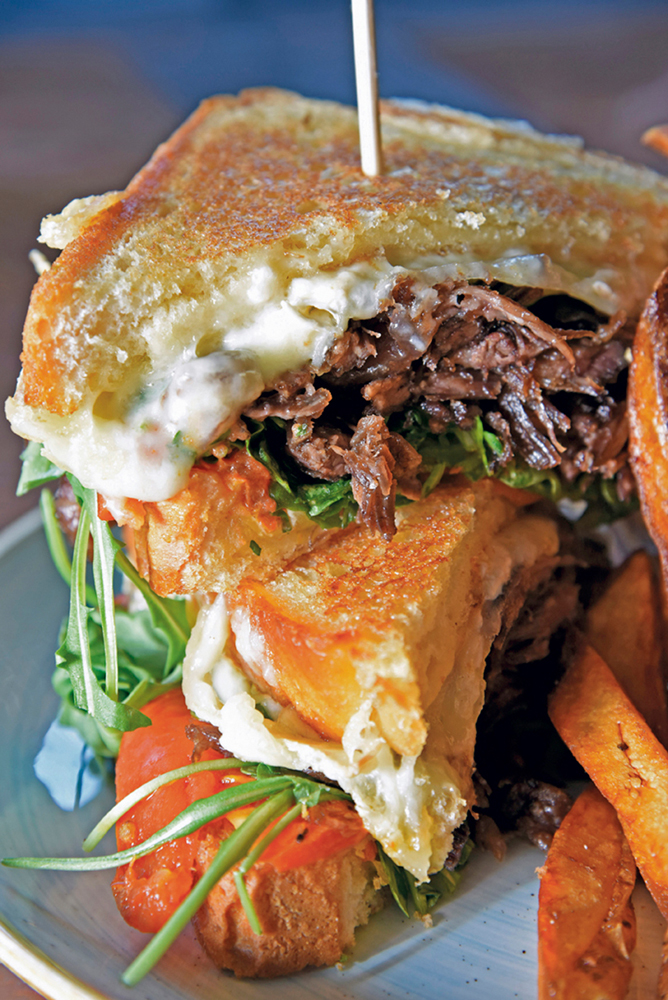 Grilled cheese of Tillamook cheddar, Brie, Swiss cheese and braised short ribs on Texas Toas