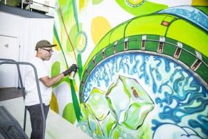 Artist at work on Sierra Mist billboard