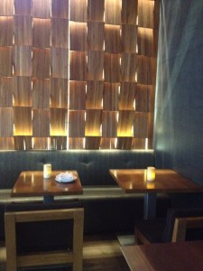 Roka Akor checkerboard wall of wood shingles
